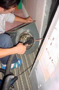 Cleaning fan coil fan motor